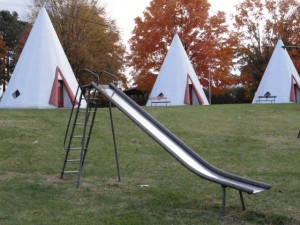 Photo by Caryn, Close up of the scary and wonderful metal slide in the children's playground within the wigwam semicircle
