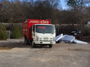 photo by caryn, junk king truck at dumped mattress site