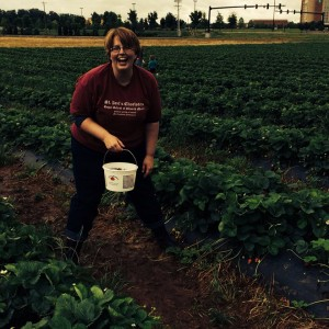 Greer not slipping on the mud while strawberry picking at Batey's Berries, Murfreesboro, TN, photo by Caryn